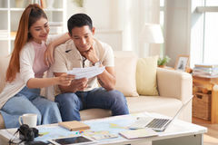 Young Asian Couple Planning Vacation Royalty Free Stock Images