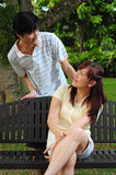 Young Asian Couple playing games 2. Couple in a park in various activities Royalty Free Stock Photos
