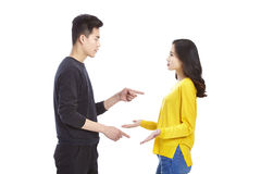 Young asian couple quarreling. Quarreling young asian couple, isolated on white background Stock Photography