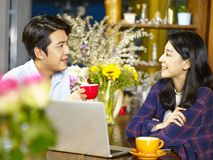 Young asian couple relaxing in coffee shop Stock Photo