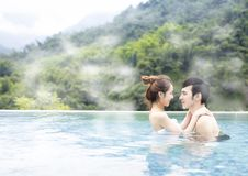 Young couple relaxing in hot springs royalty free stock image