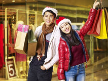 Young asian couple shopping for christmas Royalty Free Stock Photography
