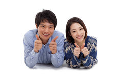 Young Asian couple show thumbs Stock Images