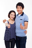 Young Asian couple show thumbs isolated on white background. Stock Image