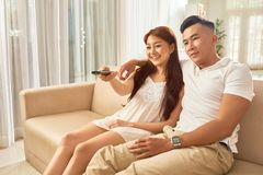 Couple watching movie at home stock images
