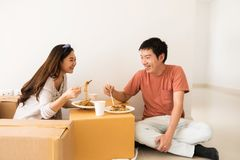 couple eat noodle at new moving house Stock Photos