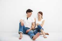 Young asian Couple Sitting On Floor Royalty Free Stock Photos
