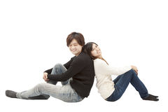 Young asian couple sitting together Royalty Free Stock Photos