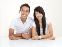 Young Asian couple smiling, looking at the camera Royalty Free Stock Photos