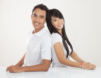 Young Asian couple smiling, looking at the camera Royalty Free Stock Photography