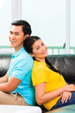 Young Asian couple on sofa or couch Stock Images