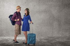 Young asian couple with suitcases looking each other Royalty Free Stock Photos