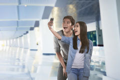 Young asian couple taking selfie by smartphone stock photo