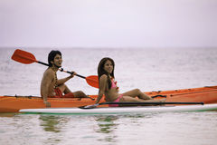 Young asian couple in their kayak Royalty Free Stock Photo