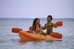 Young asian couple in their kayak Stock Image