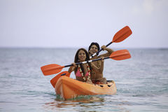 Young asian couple in their kayak Royalty Free Stock Image