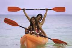 Young asian couple in their kayak Stock Photos
