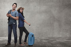 Young asian couple tourist with luggage waiting flight Stock Images