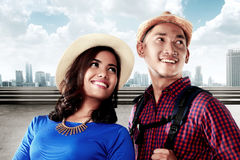 Young asian couple travel on the city smiling Stock Photography