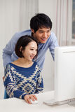 Young Asian couple using PC Stock Images
