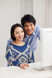 Young Asian couple using PC Stock Photo