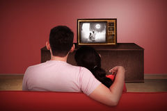 Young asian couple watching retro tv Stock Images