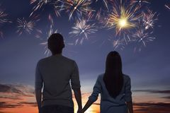 Young asian couple watching spectacular fireworks. On the sky stock photos