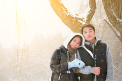 Young asian couple in winter snowing Stock Images