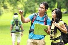 Young asian couples backpacking, outdoor Royalty Free Stock Photo