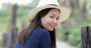 Young asian cowgirl woman portrait outdoors. stock video footage
