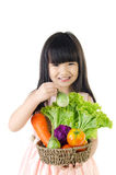 Young asian cute girl with vegetable Royalty Free Stock Photos