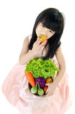Young asian cute girl with vegetable Royalty Free Stock Images