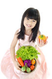 Young asian cute girl with vegetable Stock Images