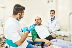 Young asian dentist doctors at work Royalty Free Stock Image