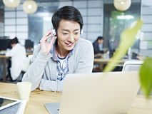 Young asian designer working in office Stock Photography