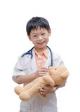Young Asian doctor boy playing and curing bear toy Stock Photography