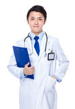 Young asian doctor with clipboard Royalty Free Stock Images