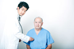 A young Asian Doctor comforting a Senior adult patient Stock Photos