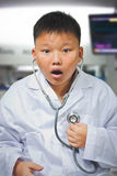 Young asian doctor discover his heart problem. A Young asian doctor discover his heart problem Royalty Free Stock Photo