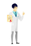 Young asian doctor holding a certificate. Asian doctor holding a certificate. Full length of doctor with certificate. Doctor in medical gown showing certificate Royalty Free Stock Image