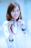 Young asian doctor portrait ,focus on stethoscope Royalty Free Stock Photos