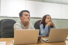 Young Asian employees carefully listening in meeting royalty free stock images