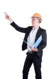 Engineer man wearing orange helmet and black suit Stock Images