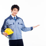 Young Asian engineer show something. Royalty Free Stock Photo