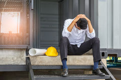 Young asian engineer suffering stress working at construction si Royalty Free Stock Photo