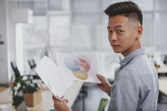 Young Asian businessman working at the office royalty free stock photo