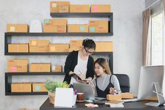 Young asian entrepreneur partners or business owners work at home office checking customer`s order together. stock photos