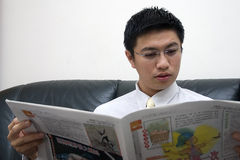Young Asian Entrepreneur Reading Stock Photo