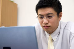 Young Asian Entrepreneur Working Stock Photo