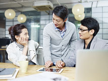 Young asian entrepreneurs discussing business in office Royalty Free Stock Image